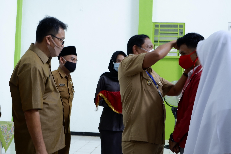 Bagikan Masker Gratis, Bupati BU Sosialisasikan Protap Kesehatan Siswa/i SLTA